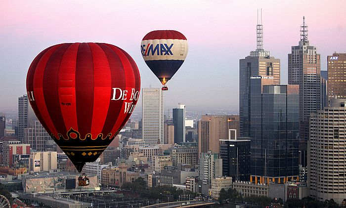 Hot air balloons fly over Melbourne skyline