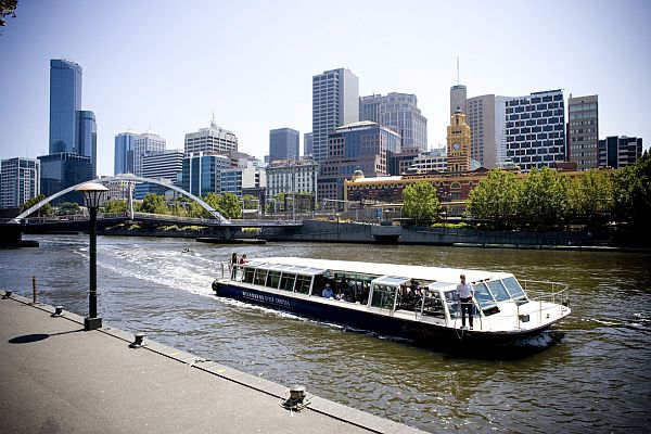 Cruise boat sails on the Yarra River in Southbank