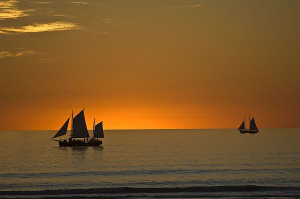 Pearl luggers at dusk off Cable Beach, in Broome